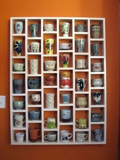 Mugs storage. Feature piece on dining room wall, nice to have larger and smaller sections.