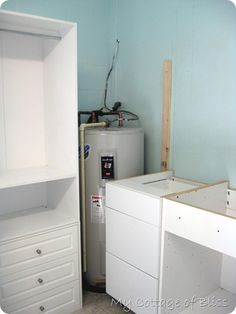 how they hid  the hot water heater, and could still have access--pics