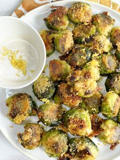 Smashed Brussel Sprouts with Parmesan and Lemon Aioli If you think you're not a fan of brussel sprouts I encourage you to try these crispy gems! This is my new favorite way to eat brussel sprouts, but I must warn you, they're very addictive! Poster Design, Healthy Sides, Vegetable Dishes, Parmesan, Side Dishes, Main Dishes, Stuffed Peppers, Vegetables, Contouring