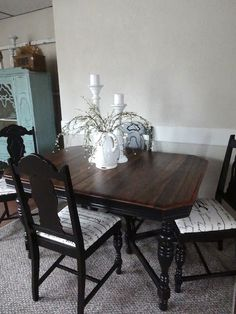 Chairs and table profile and legs painted black. Top appears natural but stained darker. Pretty contrast.