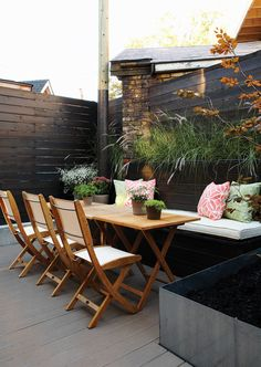 Small Urban Patio Tables and chairs fold up and can be stored away as needed.