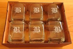 Set 6 whiskey glasses engraved with monogram. Laser cut and engraved timber box. Lid not shown This is what is capable with our co2 laser machine from Acorn laser cutting and engraving. info@acornsa.co.za