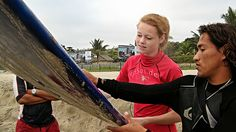 Young Woman learns Surf Lessons