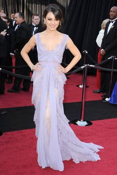 What: Elie Saab Where: Academy Awards in 2011 Why: Lilac and lace surprisely suit the tomboyish Kunis.    - HarpersBAZAAR.com