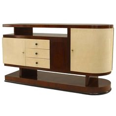 1930's Italian Walnut And Parchment Asymmetrical Sideboard | From a unique collection of antique and modern sideboards at http://www.1stdibs.com/furniture/storage-case-pieces/sideboards/