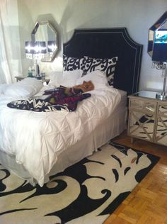 The headboard and mirrored furniture is fabulous-Glam bedroom