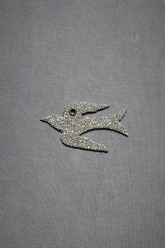 glittered mockingbird tags in silver by wendy addison from bhldn