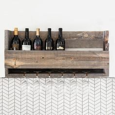 Loon Peak This wine rack is made from reclaimed wood milled from naturally aged, recycled Wyoming snow fences. 2 wall hangers are included and affixed to the back of the wine rack for easy installation into wall studs. Holds up to 8 bottles of wine. Wooden Floating Shelves, Reclaimed Wood Shelves, Wooden Wall Shelves, Wood Mill, Barn Wood, Snow Fence, Recycled Wood, Recycled Pallets, Wood Wine Racks