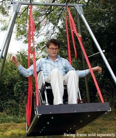 Wheel chair swing - wish I had one of these for Becca