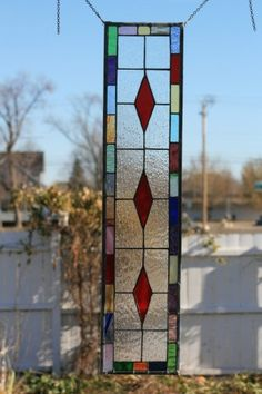 stained glass panel: Only thing that comes to mind here is that Red in the center has surrounded itself with all of the other colors, out in the open, catching the spotlight with the White team behind them - as God's Door for you and I. There is a good side to every color.  Thanks be to God. Dave, please confirm.