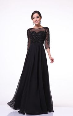 evening gown with sleeves This modest black dress has sheer three quarter length sleeves, an empire waist, and a floor length chiffon skirt. Beautiful beaded detailing decorates the bodice and sleeves. Formal Gowns With Sleeves, Plus Size Gowns Formal, Plus Size Long Dresses, Dress Formal, Formal Wear, Black Formal Gown, Prom Dresses 2015, Unique Prom Dresses, Party Dresses