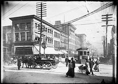 "600 block West Hastings  VPL Accession Number: 6776  Date: 1907  Photographer / Studio: Timms, Philip  Content: Looking east from Granville. Streetcars, wagons, and pedestrians. Birks jewellery store is at the corner (left) with the ""Birks"" clock out front. Also left is a policeman. [Birk's bought out George E.Trorey Jeweller in 1907 but the name on the clock remained Trorey for another year or more]"