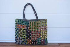 Unlined raffia and velvet bag, one pocket inside with same color as handle. Handmade in Madagascar.
