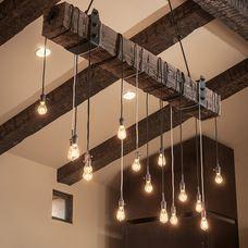 DIY light fixture with reclaimed beam and Edison bulbs