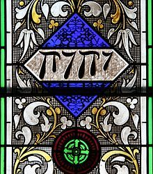 The tetragrammaton as represented in stained glass in an 1868 Episcopal Church in Iowa.