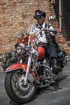 Senior African American man riding motorcycle