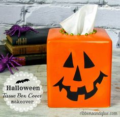 Makeover an old ceramic tissue box cover into a Halloween Tissue Box Cover with spray paint and vinyl.  So easy and fun!!
