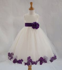 Purple Wedding Flowers We are the largest Flower girl Designer, Manufacture, and Distributor in the Los Angeles Area. Color: Ivory / Your Choice of Color Sash with Removable Flower and rose pedals wrapped in fluffy tulle. Plum Flower Girl Dresses, Purple Flower Girls, Plum Bridesmaid Dresses, Wedding Bridesmaids, Wedding Dresses, Flower Colors, Purple Wedding Flowers, Quince Dresses, Pageant Dresses