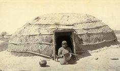 Historic photos of the Pima Indians of Arizona. A basket maker in front of a house.