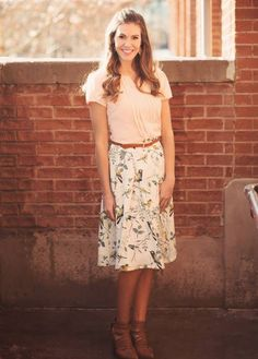 A modest knee length bird print skirt, cream with yellow and dk grey birds. Paired with the Pleated Front Top (Blush).