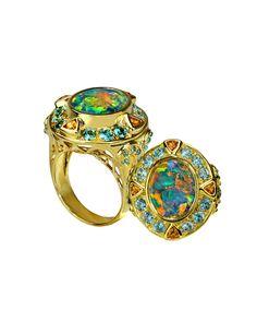Unique opal gold ring by Paula Crevoshay