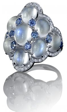 Robert Procop Exceptional Jewels A soft and glowing array of sumptuous moonstones are aligned in a sculptured dome and sprinkled with a splash of bright blue sapphire, lending a luminous and ethereal beauty to the hand it graces. I Love Jewelry, Bling Jewelry, Jewelry Box, Jewelry Rings, Jewelry Accessories, Jewelry Design, Unique Jewelry, Geek Jewelry, Vintage Jewellery