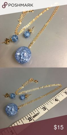 CUTE blue ball necklace and earrings CUTE little blue ball necklace with matching earrings. Never used ...brand new. Metal is of copper and ball material is acrylic. Jewelry Earrings