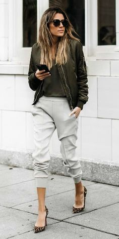 Christine Andrew + leopard print heels + cropped jogger-style pants + matching khaki top + bomber jacket + sleek black shades + spring outfit. Jacket: ILY Couture.