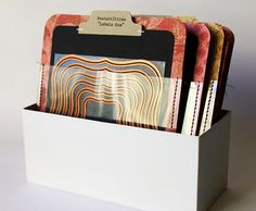 I am intimidated by spellbinders, but I covet them.  If I ever take the plunge, I'm definitely stealing this storage plan.