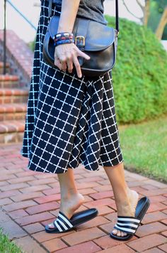 Window Pane printed midi skirt and Adidas slide sandals