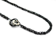 Silver textile inspired jewellery by Suzanne Claire