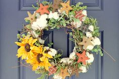 Cotton wreath with textile elements and silk flowers