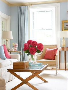 Color UpdateA traditional color scheme can be rich without being heavy. Choose colors that are light in value with warm undertones to give a traditional room space to breathe. A soft blue establishes a classic palette in this polished living room, while pops of deep pink add playful luxury.