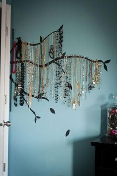 Pins the jewelry to the wall with tacs....could use nails