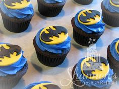 Batman cupcakes. Chocolate cake with blue, vanilla flavoured, buttercream frosting and a yellow and black fondant Batman topper.