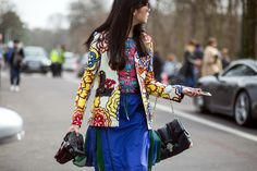 Cobalt blue skirt and floral patterns on the street at Paris Fashion Week // photo credit: The Styleograph