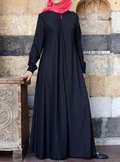 asked for it, and we are happy to oblige: Finally, a wrinkle-resistant version of our popular abayas! The name says it all, and it's as easy to wear as it is to care for. Elasticized sleeves, a front opening, and the perfect flattering, feminine flair work together to create one beautiful, practical piece you'll be reaching for day after day.