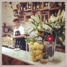 Our Barman hard at work! Restaurant, Table Decorations, Gallery, Furniture, Home Decor, Decoration Home, Roof Rack, Room Decor, Diner Restaurant