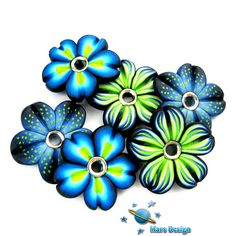 Handmade flower beads, by Marcia - Mars Design via Flickr.