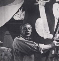 """picasso at work on """"Guernica"""". 1937. """"""""What do you think an artist is? ...he is a political being, constantly aware of the heart breaking, passionate, or delightful things that happen in the world, shaping himself completely in their image. Painting is not done to decorate apartments. It is an instrument of war."""" (Picasso)"""