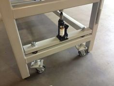 Welding table with bottle caster mechanism