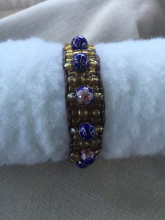 A personal favorite from my Etsy shop https://www.etsy.com/listing/275310174/beaded-fitbit-bracelet