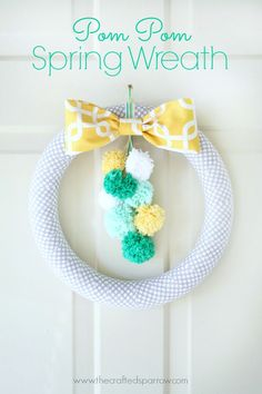 use eggs for easter, after easter, change to the poms. could even use the same wreath year round and just change the bow and poms!