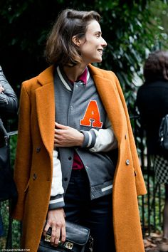 This is a great look, I love the masculine feel of both the overcoat and the varsity, but the bright pops of color that build upon an unisex look.