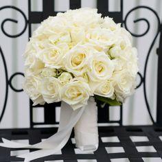 White Romantic Rose Bouquet // James Bass Photography // Whistlestop Florist, Inc. // http://www.theknot.com/weddings/album/145644