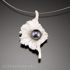 """.....Solanum.....  Pendant 1.5""""x 1.0"""" x 0.25""""    Sterling silver, Akoya pearl    Solanum is an omen of good fortune and is also an emblem of love and affection. In nature, Solanum blooms out in just a couple days, but your Silver Solanum will remind you of spring all year round."""