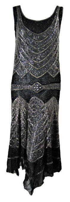 1920's Beaded Sheath Dress with Tromp L'oeil Detailing - https://www.1stdibs.com/fashion/clothing/evening-dresses/1920s-beaded-sheath-dress-tromp-loeil-detailing/id-v_56713/