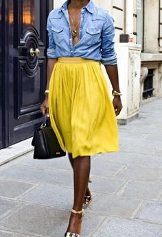 Love everything, yellow skirt, denim top, glossy black door with center door handle