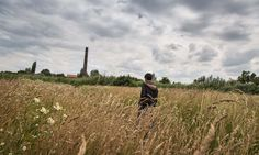 'An Afghan migrant walks among the fields surrounding an abandoned brick factory on the outskirts of Subotica, Serbia. Migrants call the space the jungle.'