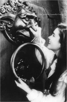 Jennifer Connelly as Sarah and David Bowie as Jareth in the magical ballroom scene in 'Labyrinth' Movie 1986 pinching nose of door knocker della door David Bowie Labyrinth, Labyrinth 1986, Labyrinth Movie, Stanley Kubrick, Jim Henson Labyrinth, John Beck, The Neverending Story, Goblin King, Fantasy Films